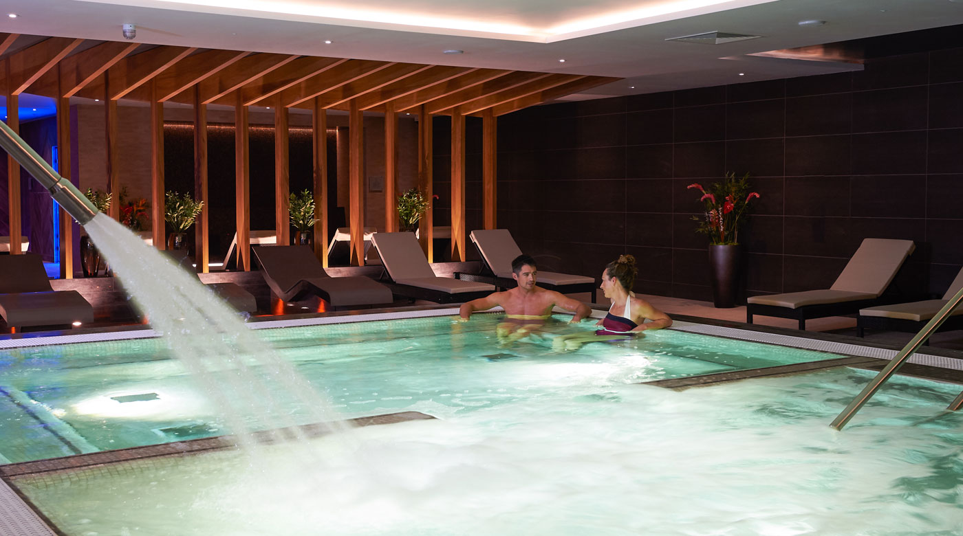 Image of people relaxing in the spa at David Lloyd Cambridge