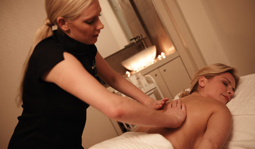 Image of a lady receiving a massage at a spa
