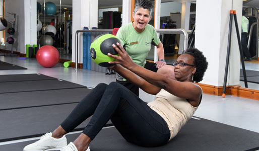 Image of female PT and client with medicine ball