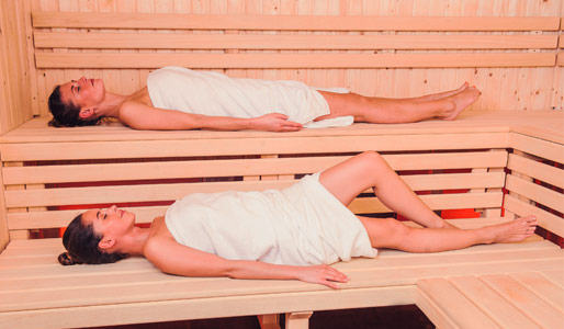 Image of two ladies relaxing in the sauna