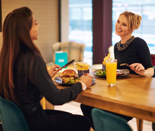 Image of women sitting and eating in the Clubroom