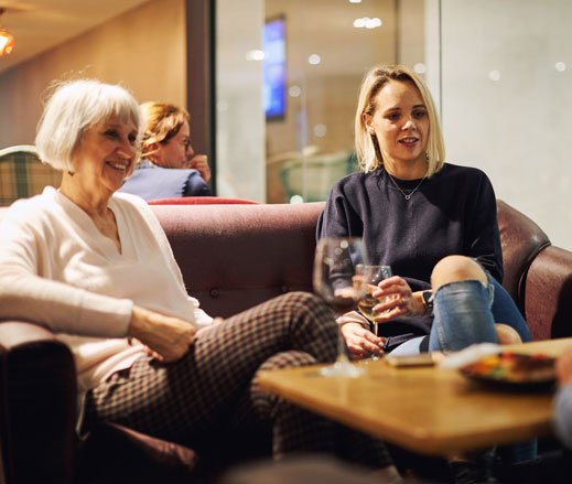 Image of ladies sat relaxing in the Clubroom at David Lloyd Clubs