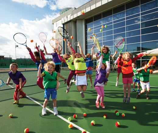 Image of group of kids enjoying tennis activities at David Lloyd