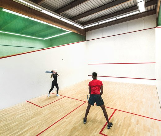 Image of players on squash court