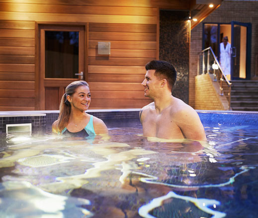 Image of a man and a woman enjoying time relaxing in the hydro pool