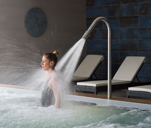 Image of lady relaxing in the hydro pool at David Lloyd Chigwell