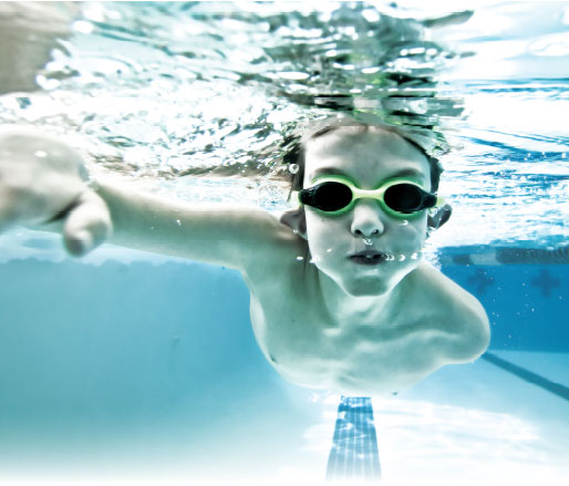 An underwater shot of a child swimming.