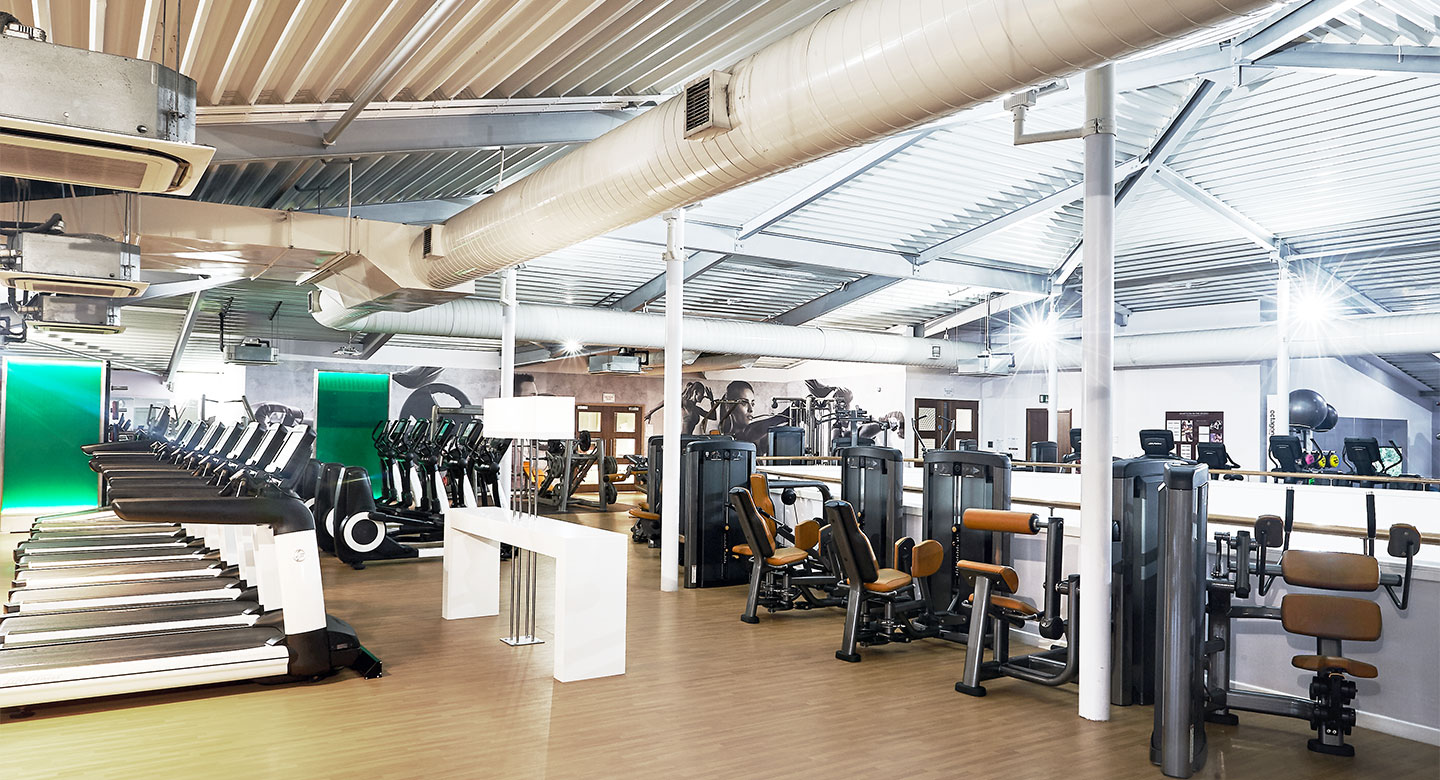 A large area with lots of fitness & fixed weight machines.
