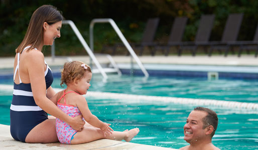 Image of family in the outdoor pool at David Lloyd Chigwell