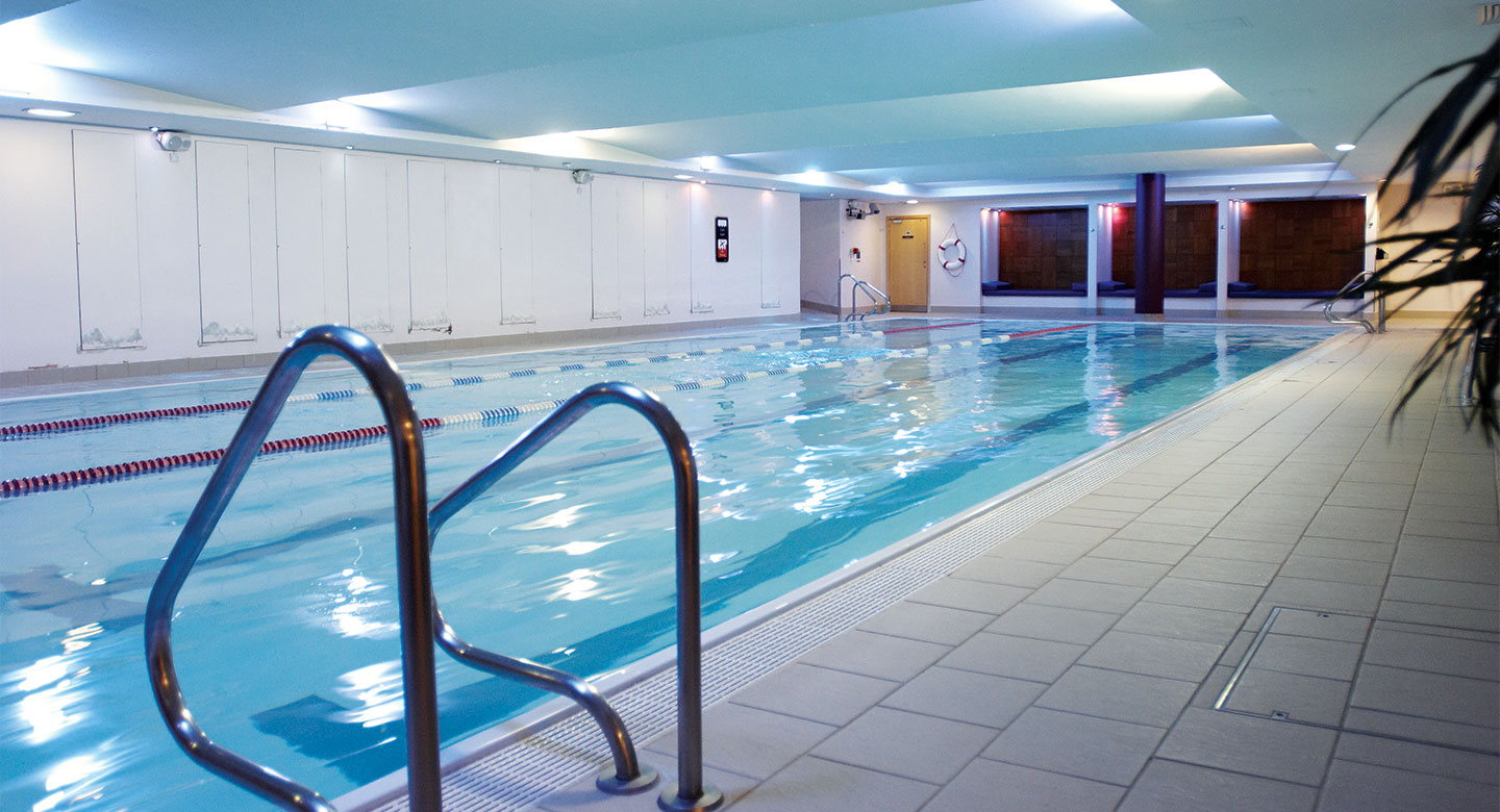 A bright indoor swimming pool.