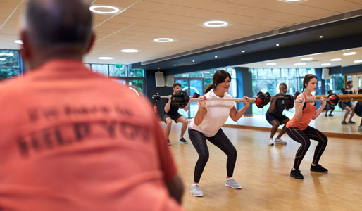 Image of a group of members doing a bodypump class at David Lloyd