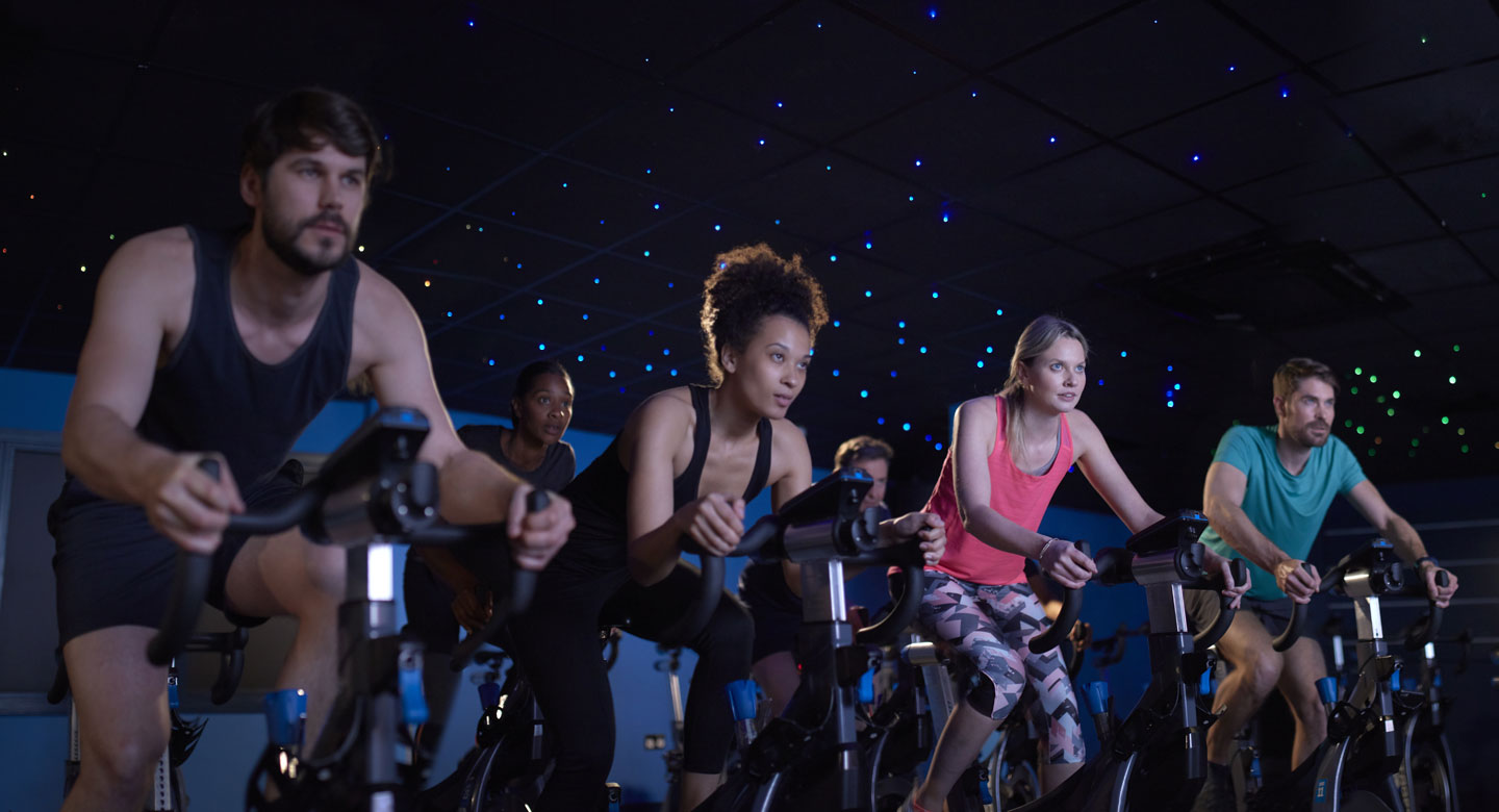 Image of a group of people in a group cycling class at David Lloyd