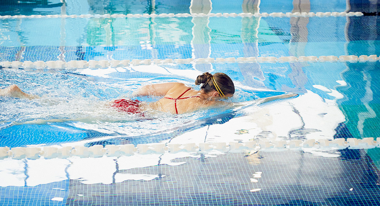 Image of a lady swimming in the indoor pool at David Lloyd Royal Berkshire