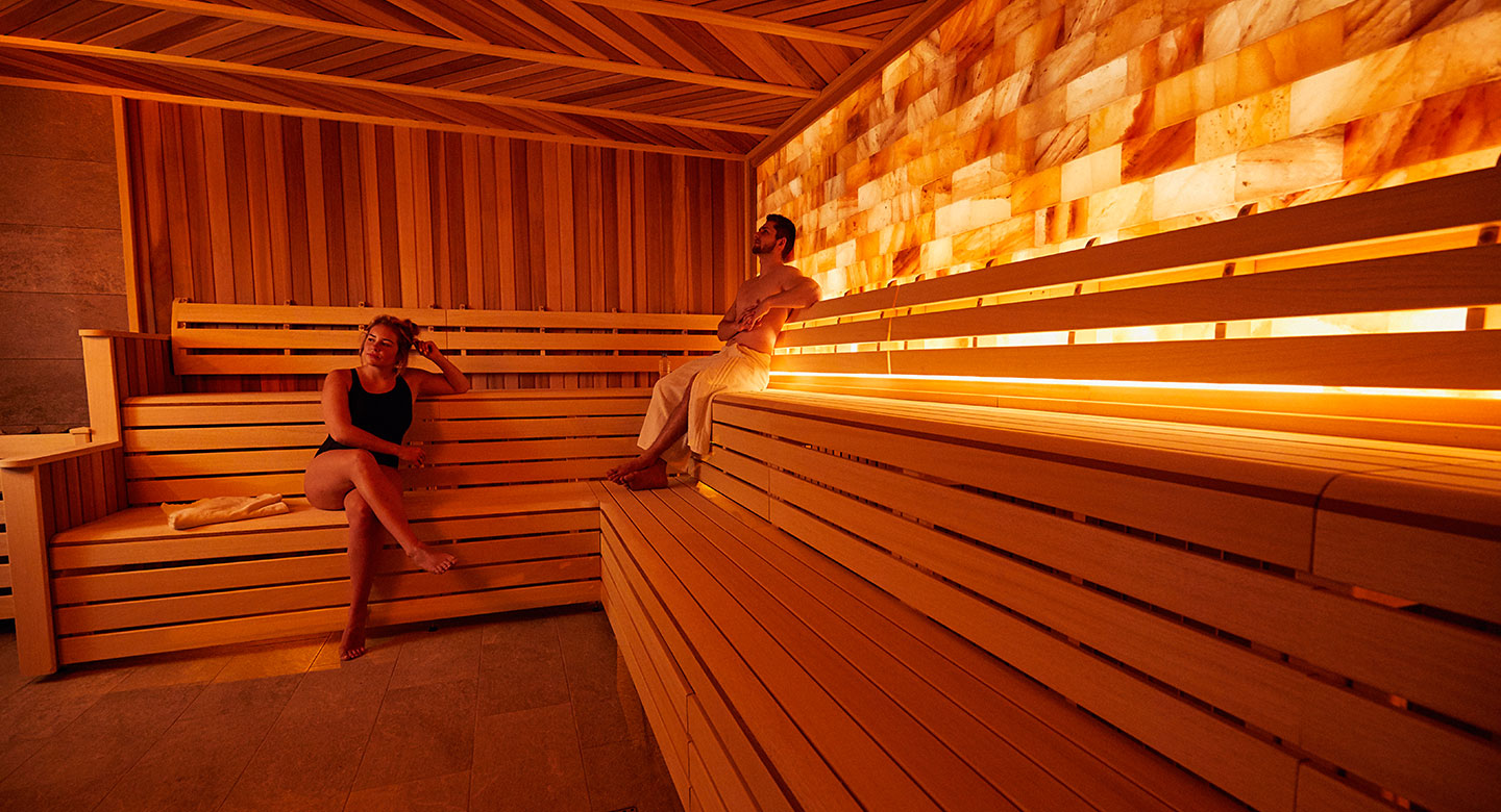 Image of a man and a woman in the sauna at David Lloyd Royal Berkshire