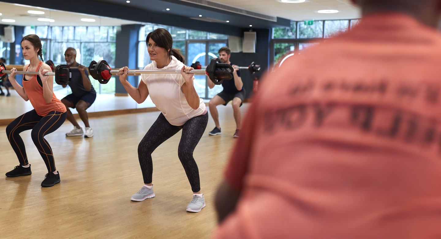 Image of a group of people taking part in a Bodypump class