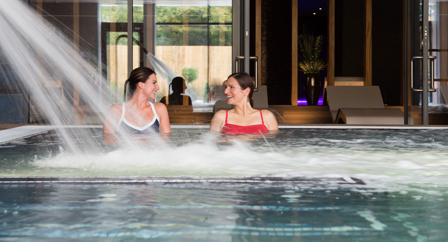 Image of women enjoying time in the hydro pool in the Spa Retreat at David Lloyd