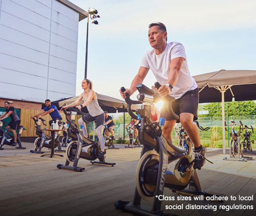 Image of group cycling class outdoors at David Lloyd