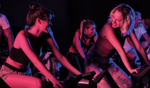 Image of women during a group cycling fitness class