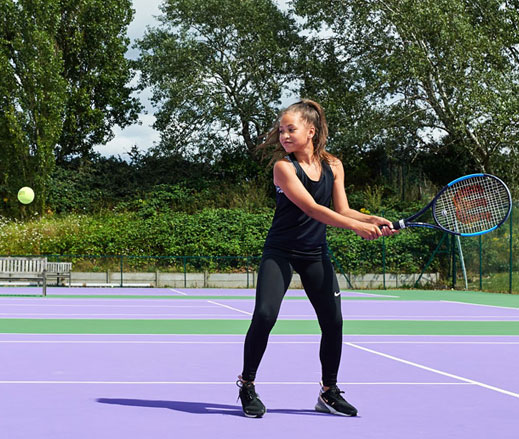 Image of a girl hitting a backhand