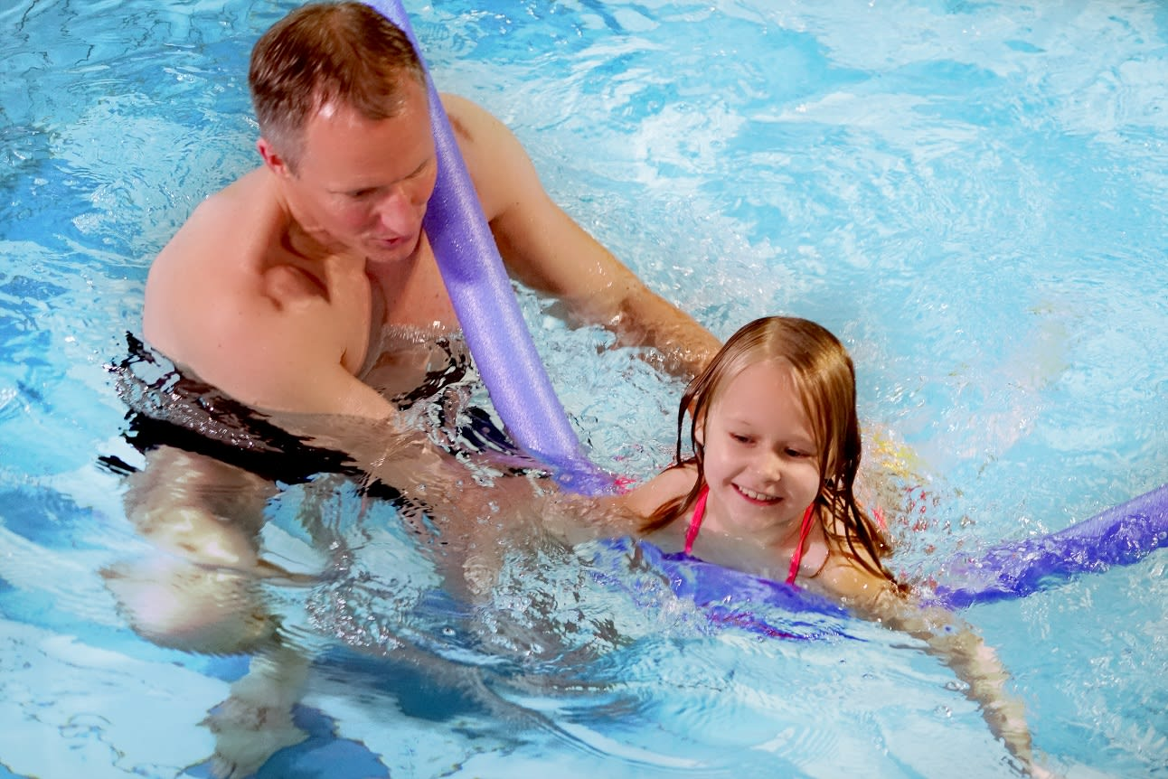 Man swimming with child