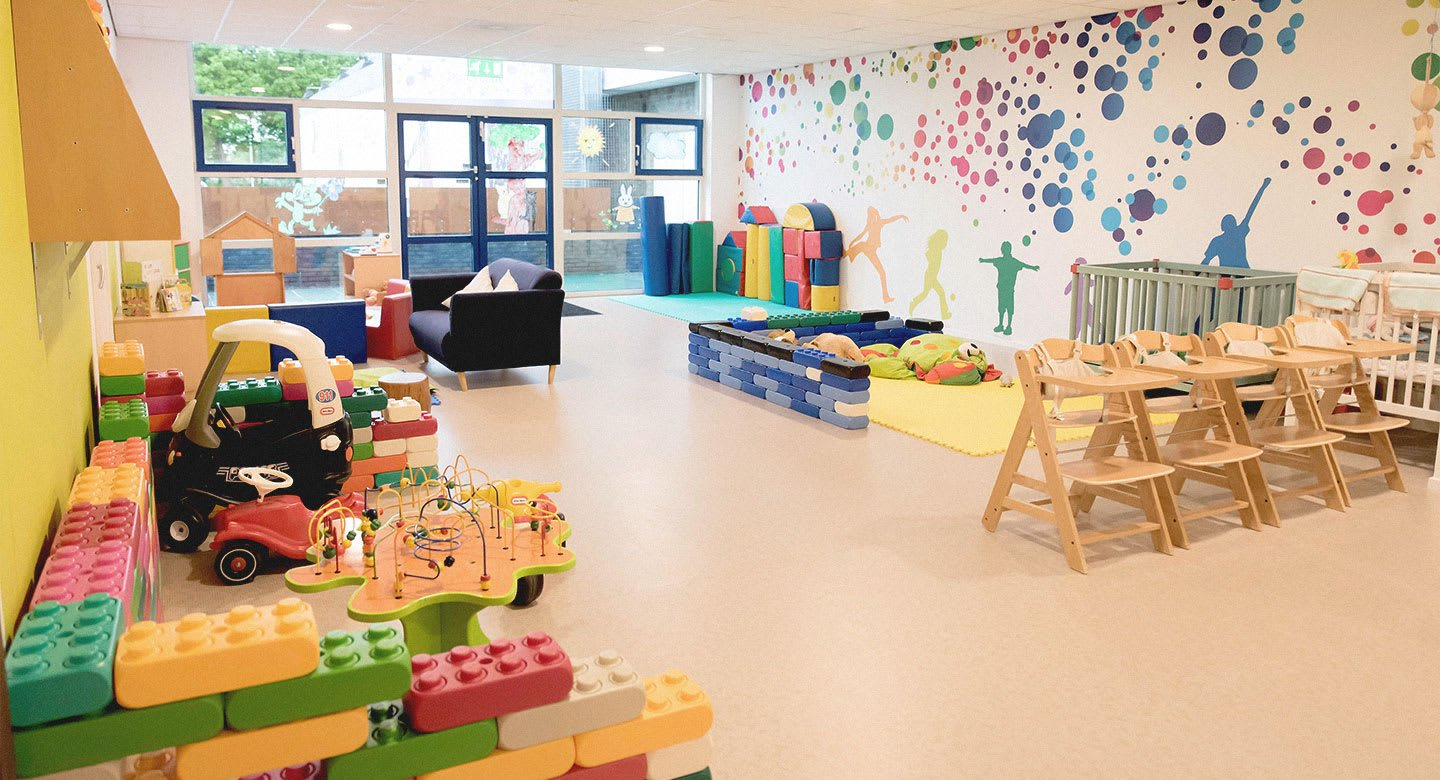 A child laughing with delight at the David Lloyd crèche