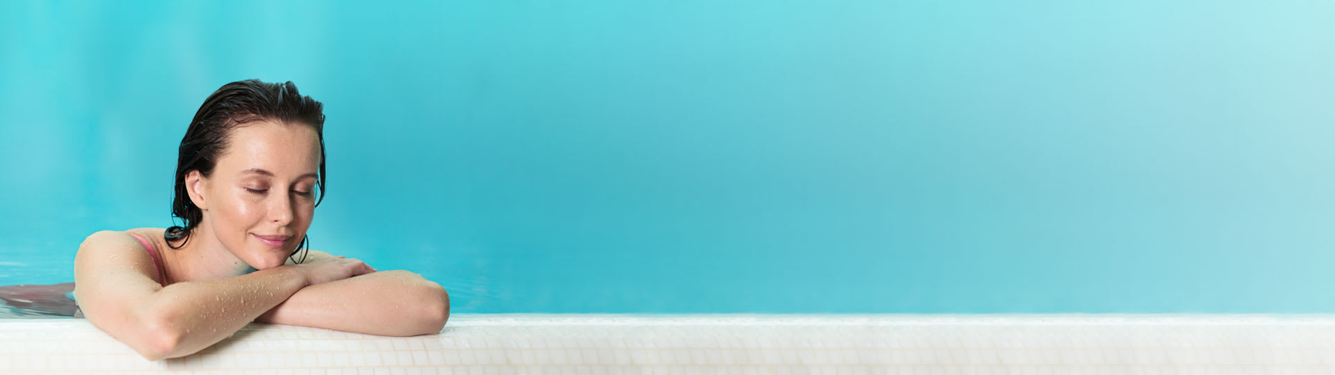 A woman relaxing in a blue pool