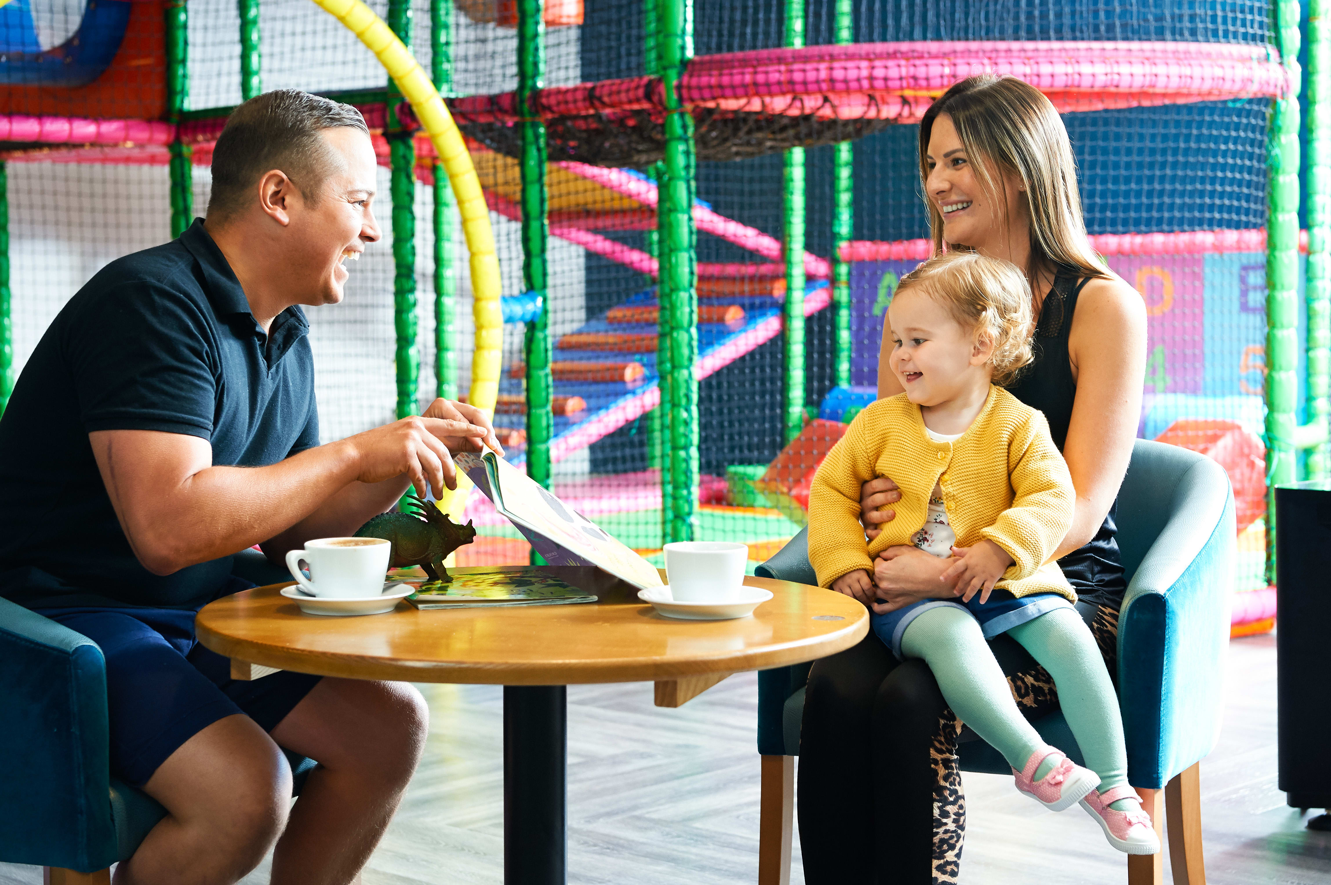 Child smiling at family and kids activities