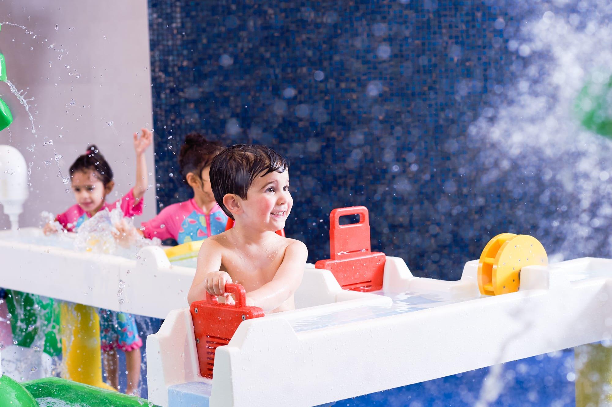 Boy enjoying splash zone at David Lloyd Cambridge