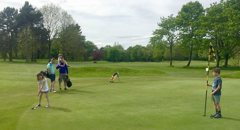 Family playing golf at Hampton