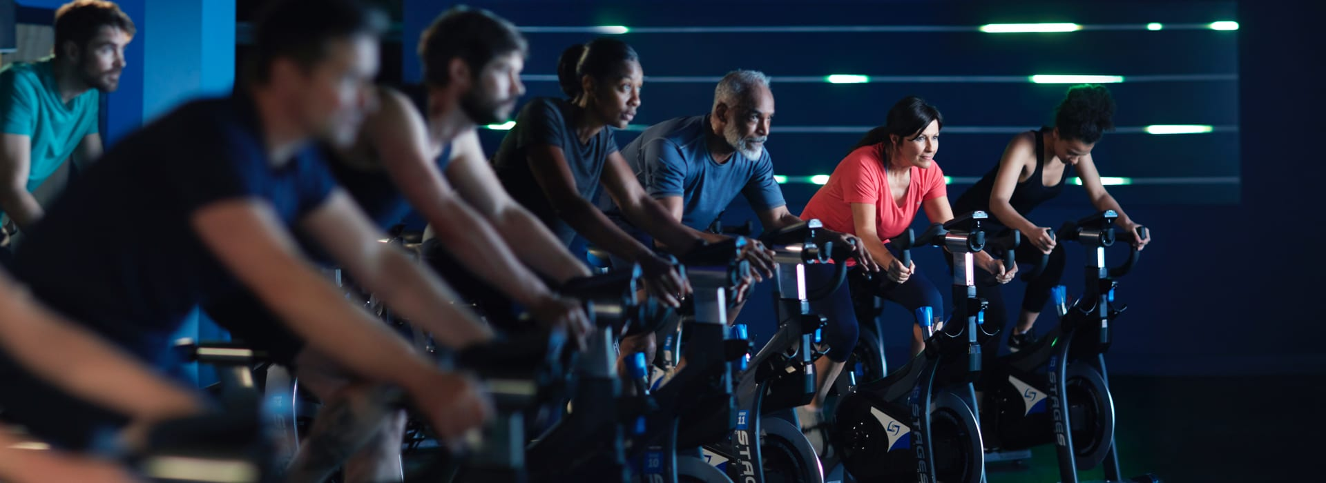 A group of people cycling in an exercise class
