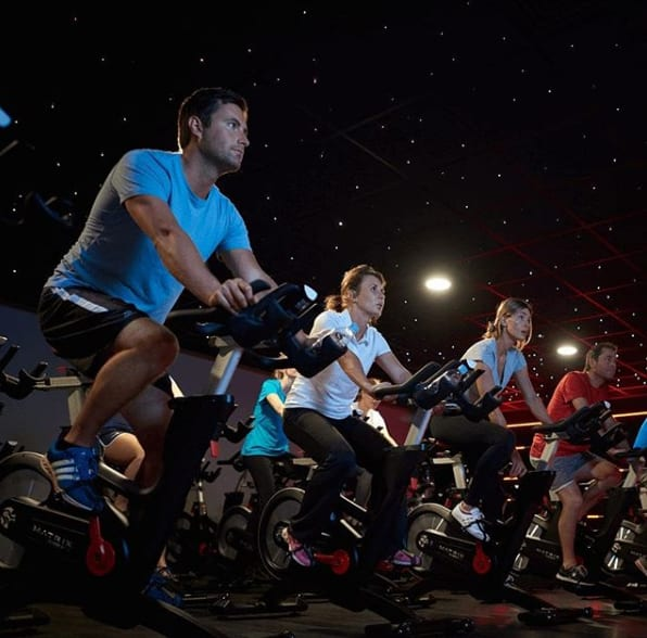 A group cycling class in progress