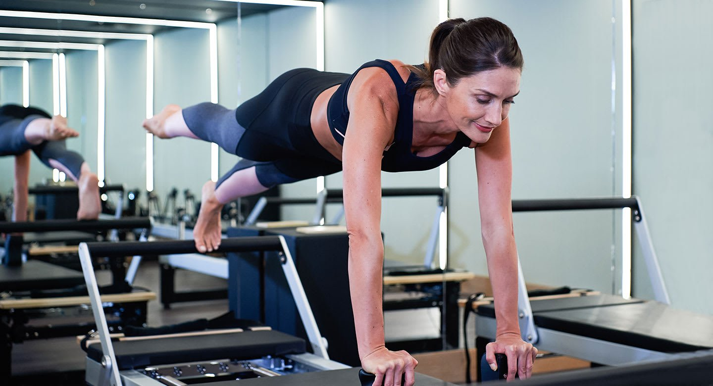Image of woman during reformer pilates class