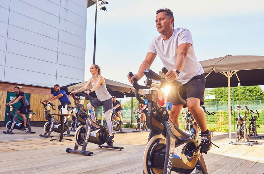 Image of outdoor group cycling class at David Lloyd Clubs