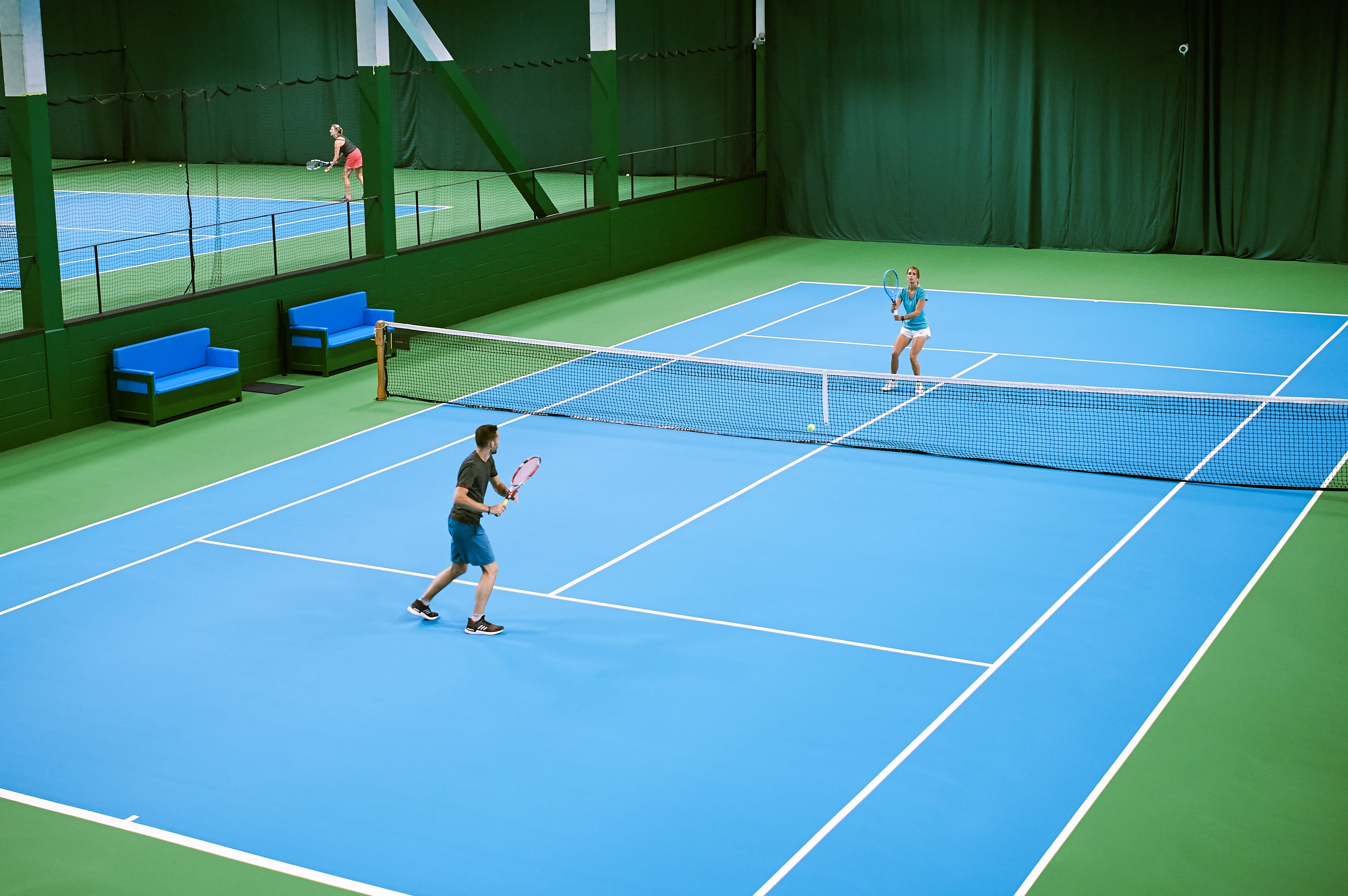 The expansive multi-court indoor tennis space at the club