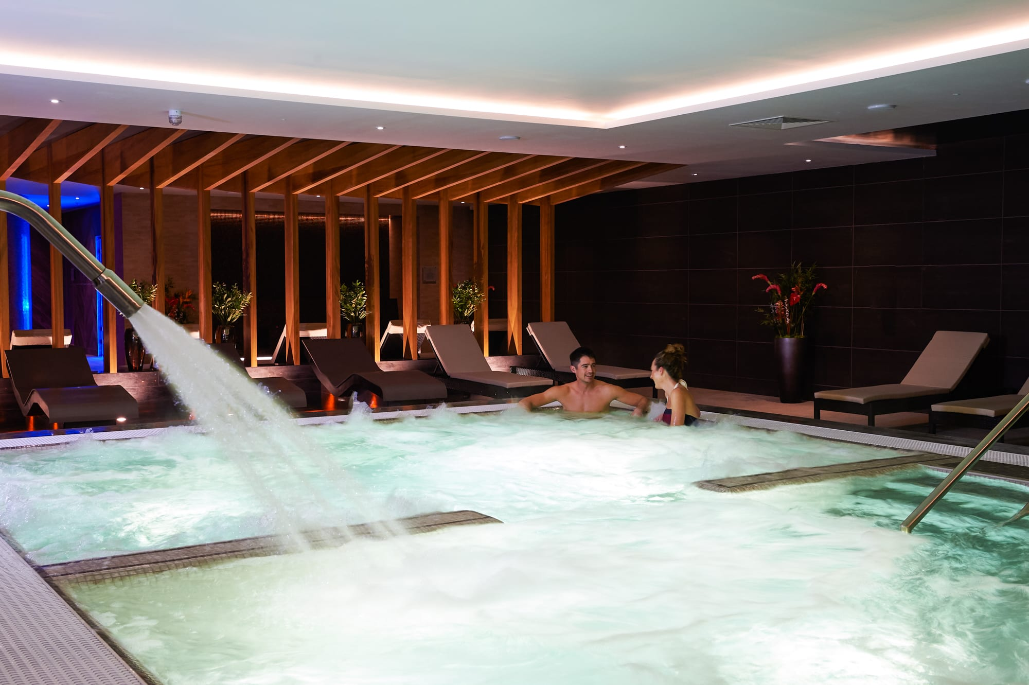 Image of people relaxing in spa at David Lloyd Clubs