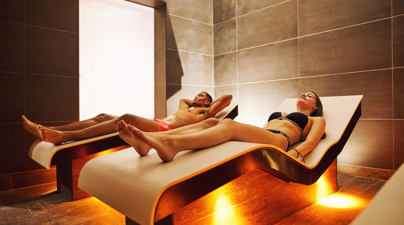 Two friends enjoying their time in the steam rooms and sauna