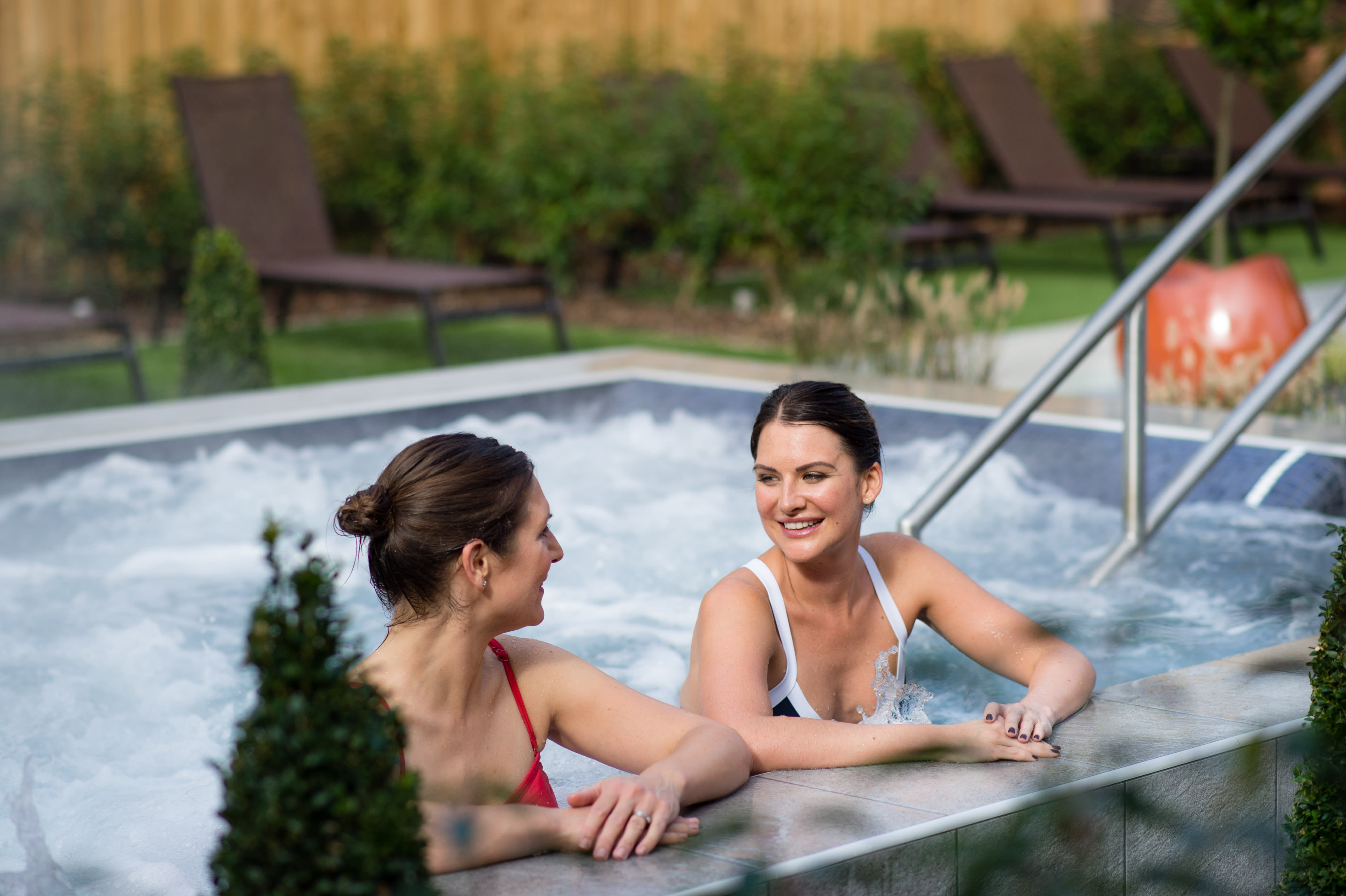 Two friends enjoying the whirlpool in the Spa Garden
