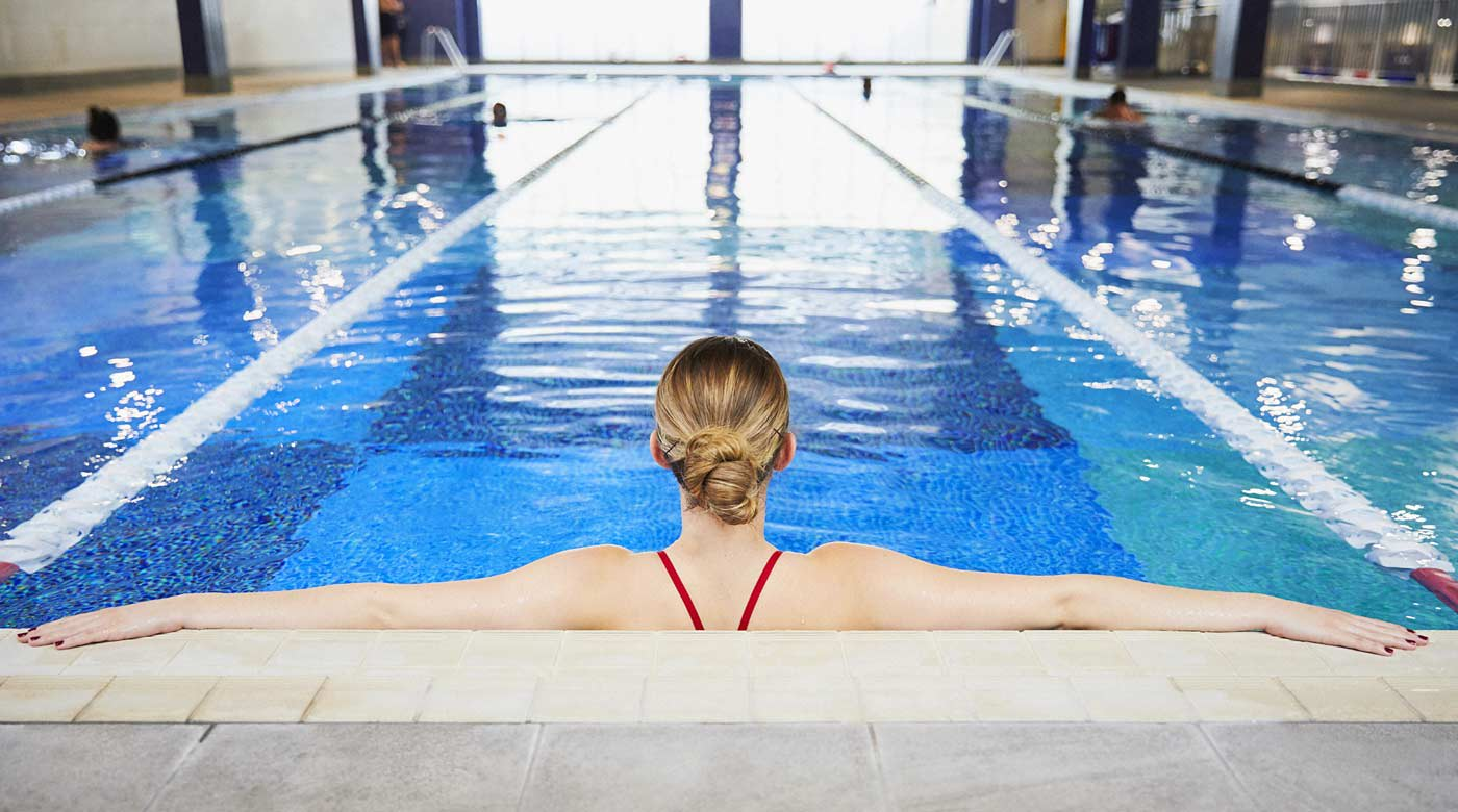 Image of swimmer relaxing in indoor pool at David Lloyd Clubs