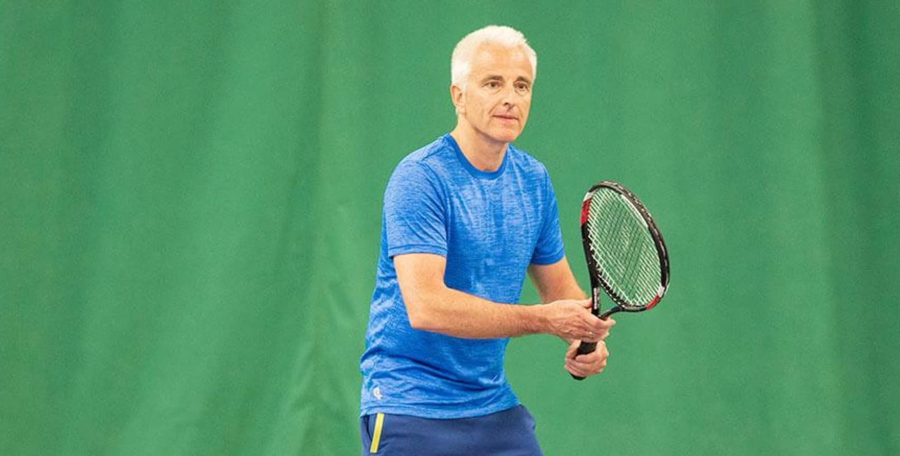 A man enjoying a game of tennis