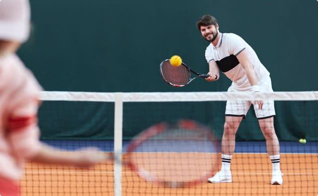 People enjoying a game of tennis