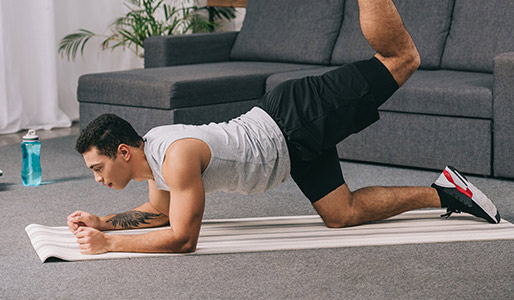 Image of man taking part in at home workout