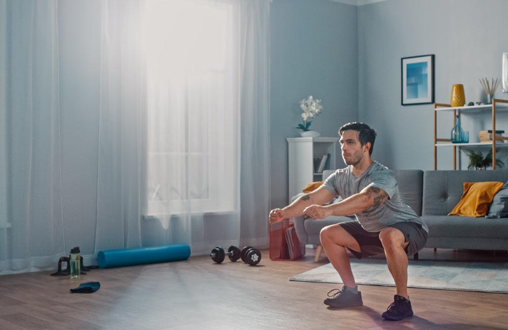 Image of man squatting