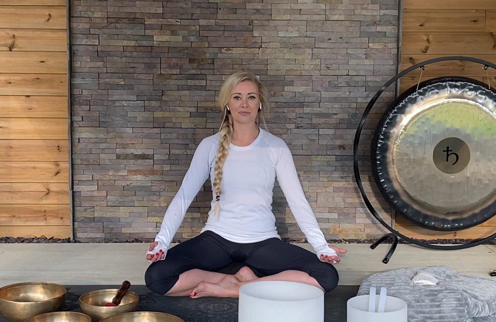 Image of Carlie leading meditation session