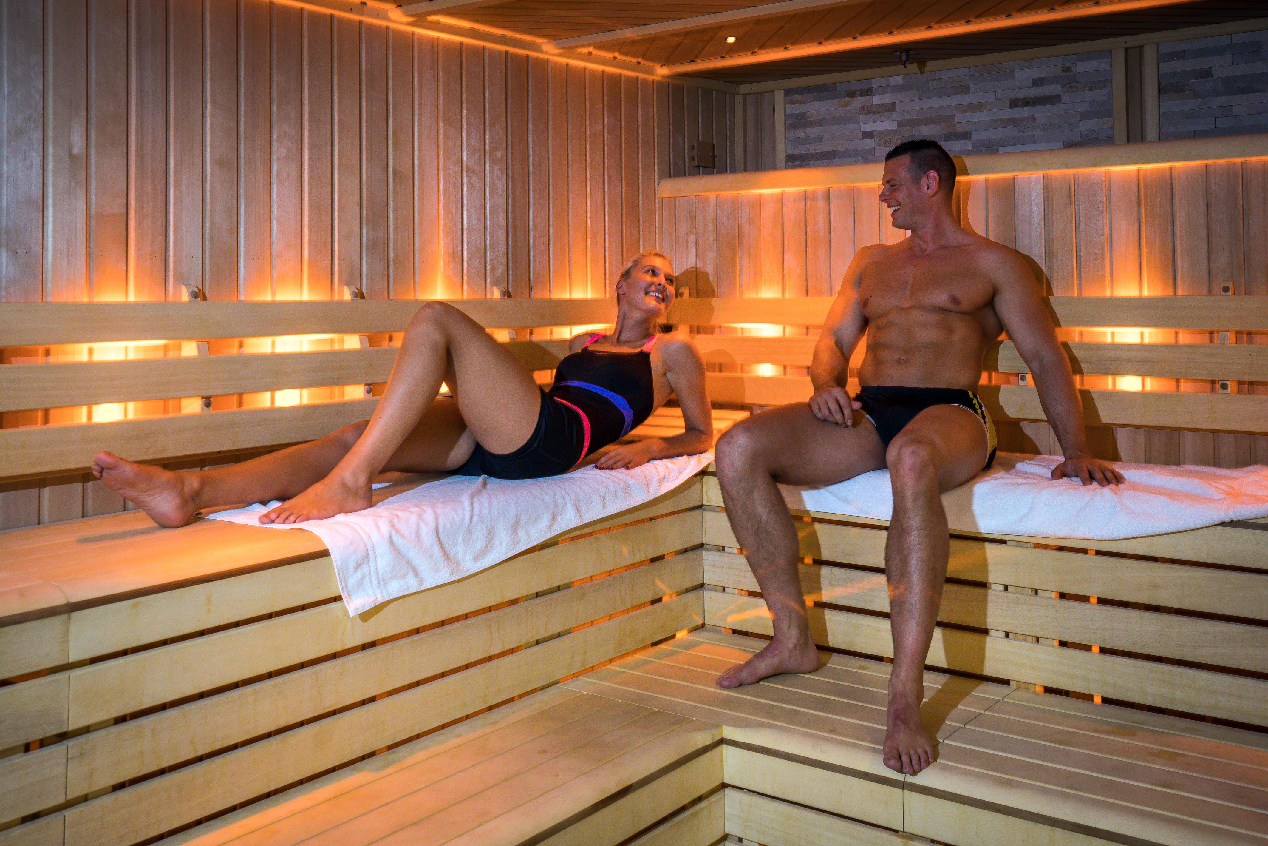 Two friends enjoying their time in the sauna