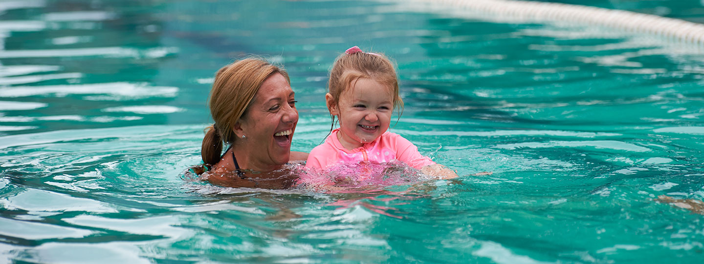 Lady swimming with child