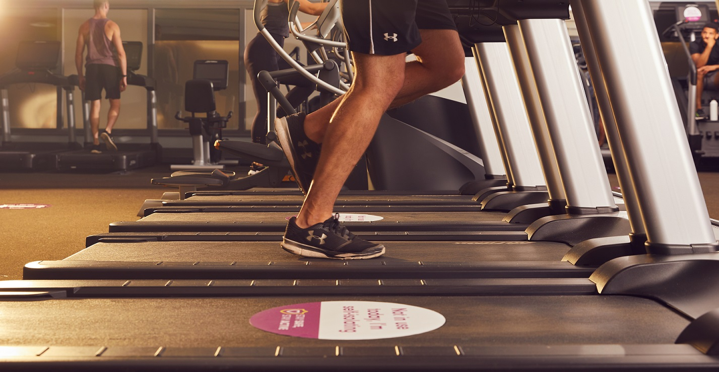 Socially distanced runners on treadmill