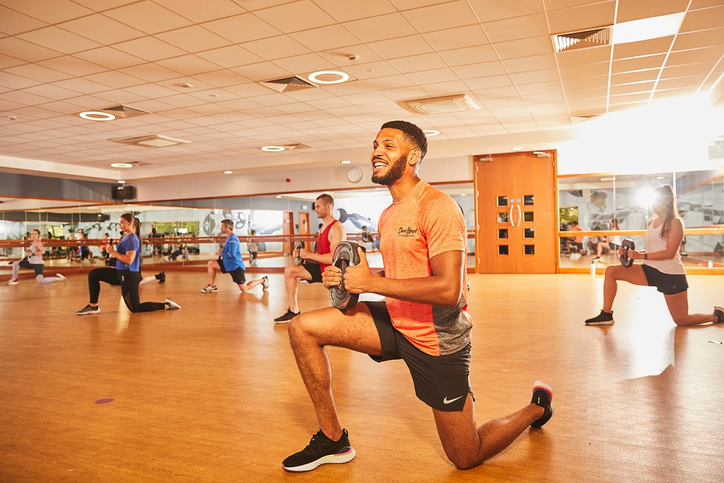 Instructor leading fitness class