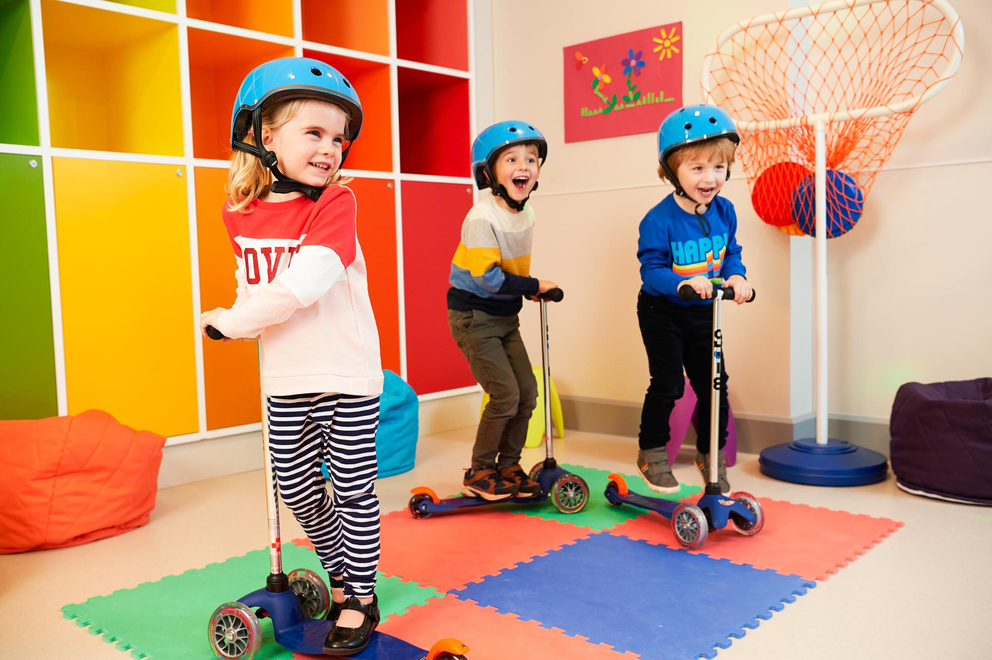 Children enjoying scooter squad