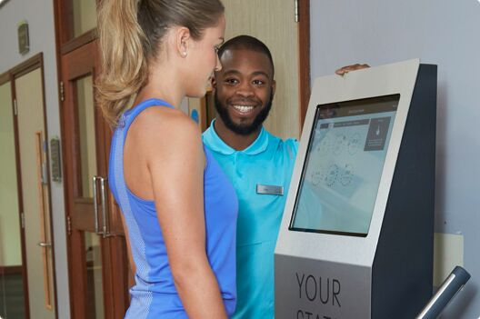 A PT helping a gym member achieve their fitness goals with Boditrax measurement systems