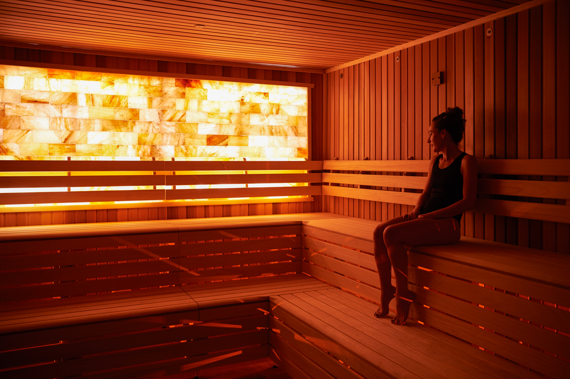 A woman relaxing in the sauna